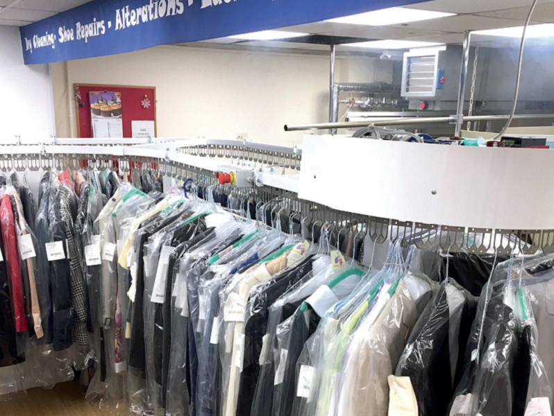 Conveyor systems for laundry and dry cleaning